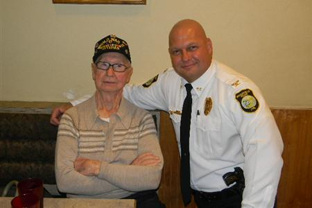 Police Officer with Arm Around Veteran